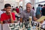 Jesse Kraai with a student at chess camp.